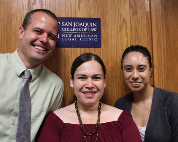 NALC Director Professor Gregory Olson, Client Services Coordinator Aracely Mota, and Administrative Assistant Ana Yansi Gonzalez stand ready to greet new clients.
